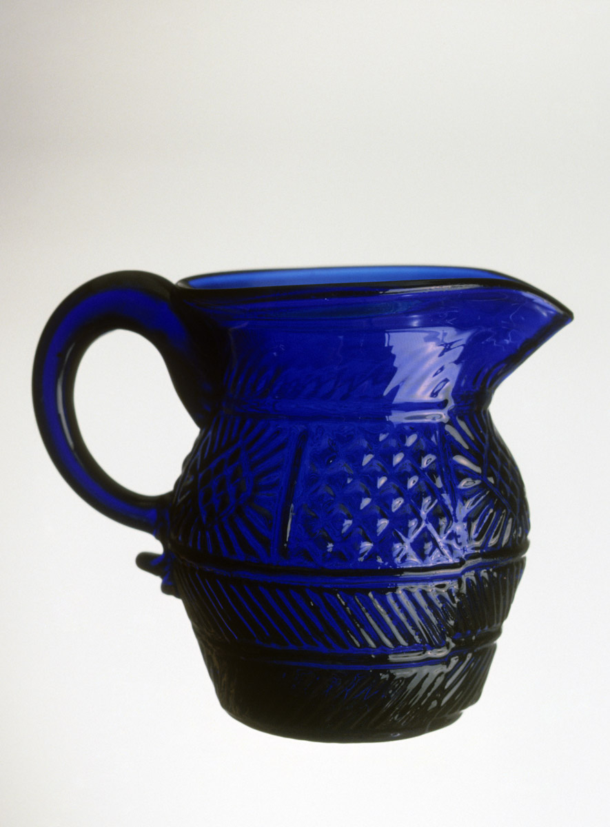 1957.0010.003 Blue glass jug