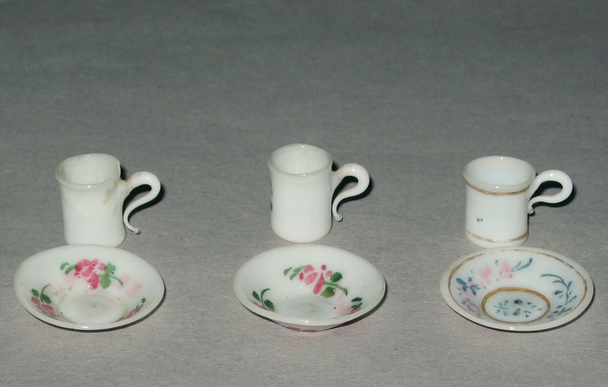 1959.0998.016, .019, .012, .011, 1964.1396.003, 1964.1397.005 Miniature glass teacups and saucers
