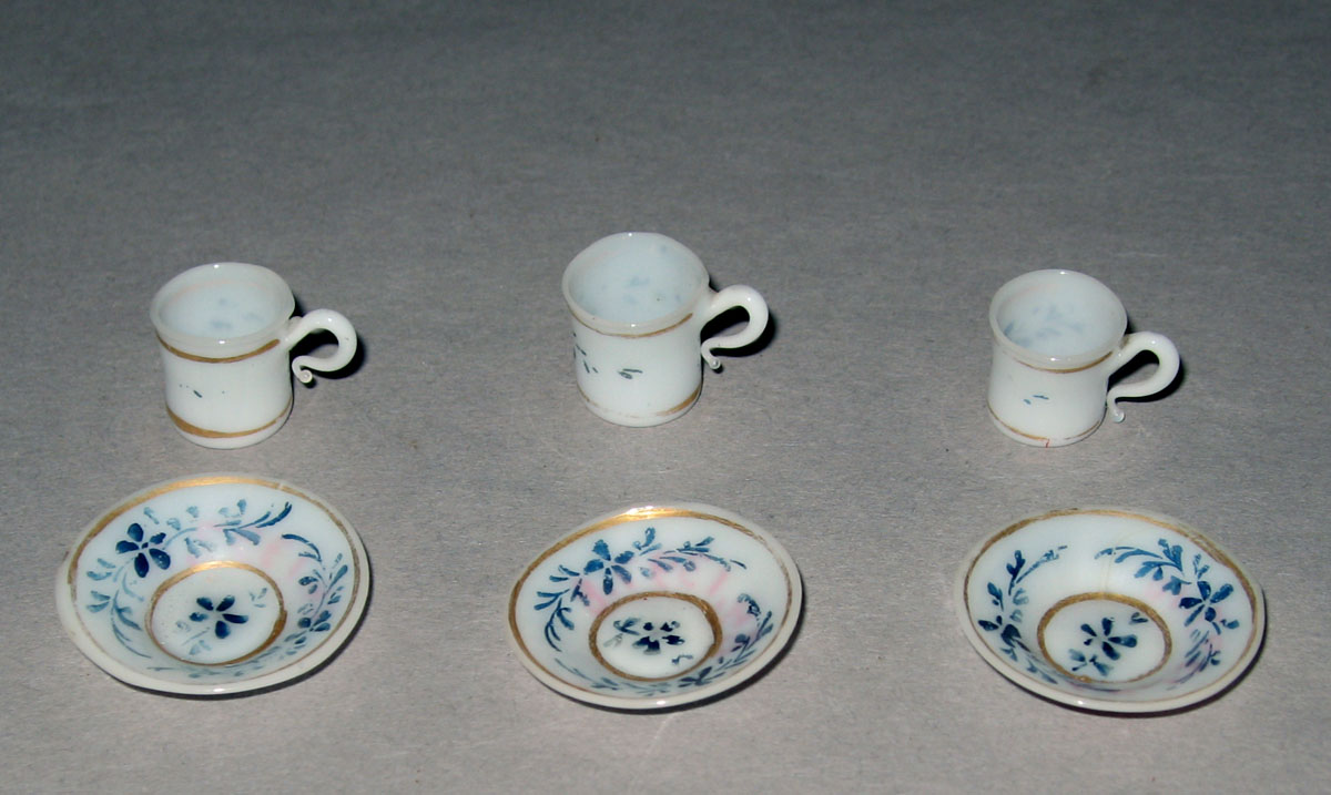 1964.1397.001, .002, .004, .011, .008, .010 Miniature teacups and saucers