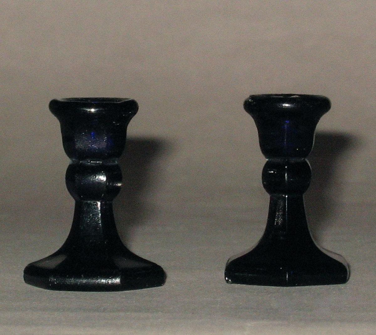 1964.1468.001, .002 Miniature glass candlesticks