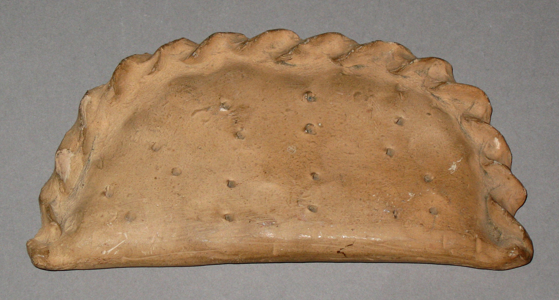 1964.1679 Chalkware pastry or turnover