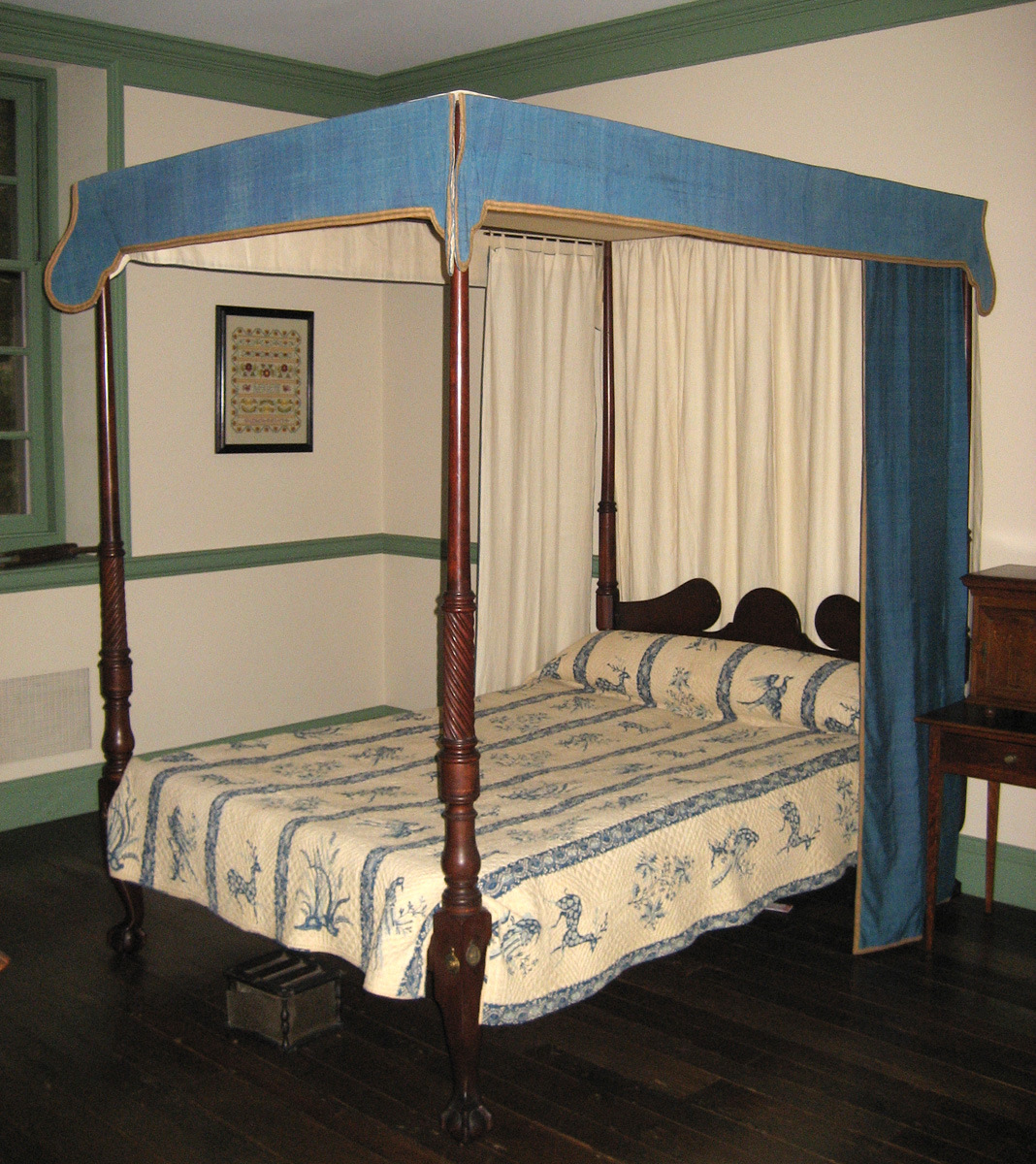 1957.0040.002 bedstead with bed hangings 1964.0512 and quilt 1955.0656 J, K view 1