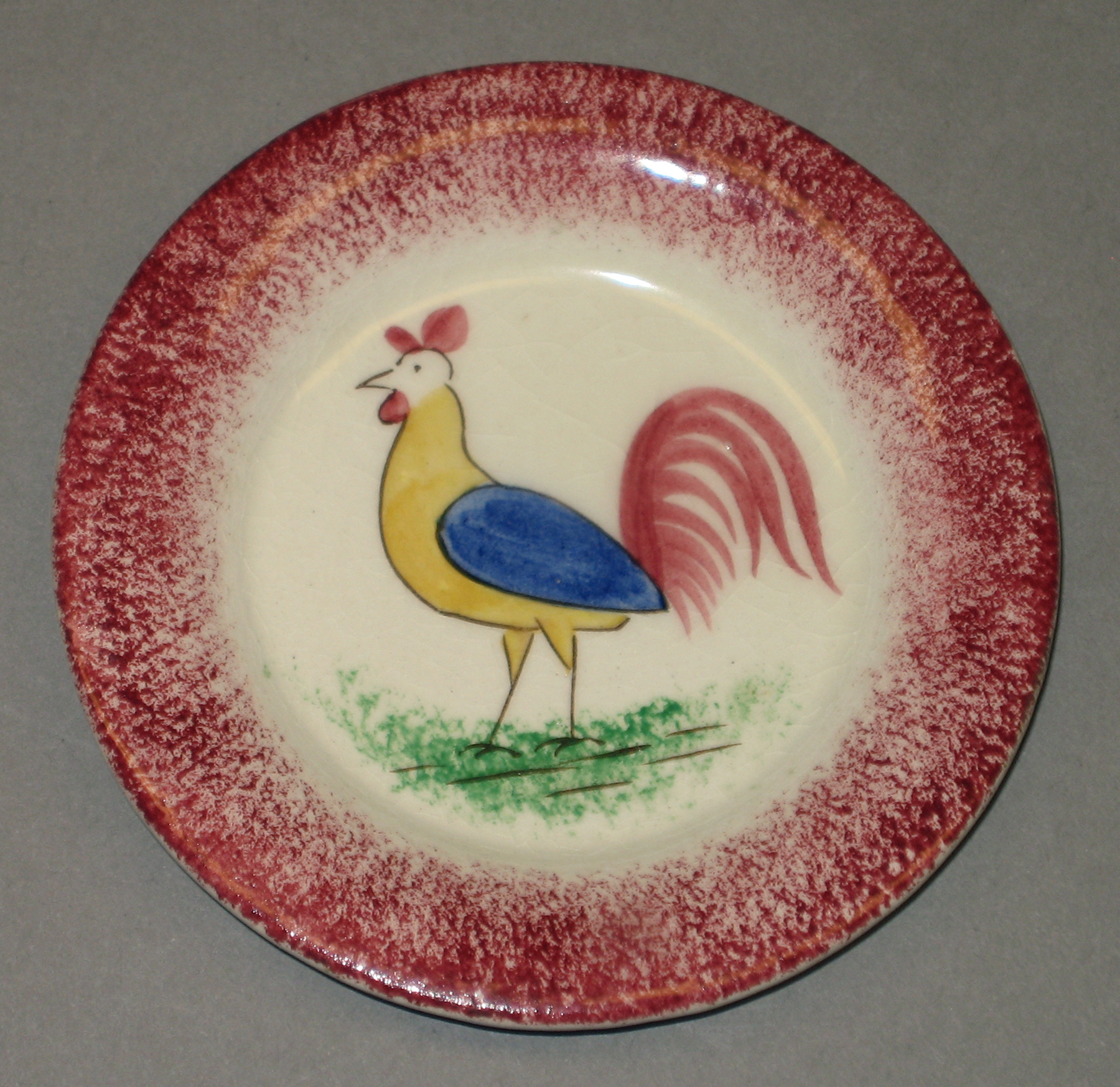 1954.0003.006 Spatterware cup plate